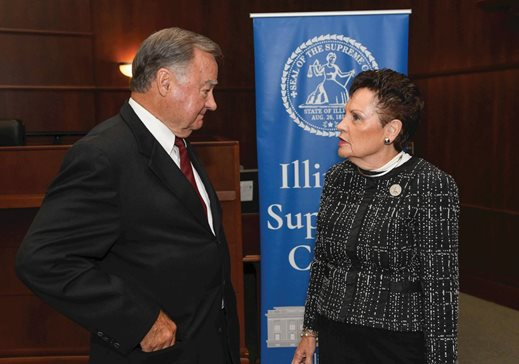 Illinois Supreme Court Justices Lloyd Karmeier and Rita Garman talk Oct. 2 in Chicago during an event to unveil the Judicial Conference's strategic agenda for the state's courts. Karmeier announced he will resign from the bench effective Dec. 6, 2020.