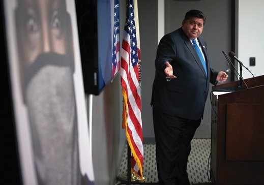 "Gov. J.B. Pritzker unveils a new mask awareness campaign called ""It Only Works If You Wear It"" during a press conference at the Illinois Emergency Management Agency's State Emergency Operations Center in Springfield on Monday. The new $5 million campaign will encourage Illinois residents to wear a face covering every time they're in public to slow the spread of the COVID-19 virus."
