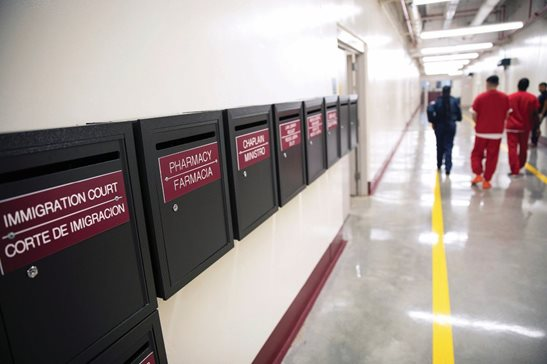 Mailboxes for various departments line a hallway as detainees walk through the Stewart Detention Center in Lumpkin, Ga., last week. The rural town is about 140 miles southwest of Atlanta and next to the Georgia-Alabama state line. The town's 1,172 residents are outnumbered by the roughly 1,650 male detainees that U.S. Immigration and Customs Enforcement said were being held in the detention center in late November.