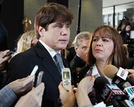 Former Gov. Rod Blagojevich speaks to reporters as his wife, Patti, listens at the federal building in Chicago in this file photo from Dec. 7, 2011. Today, the U.S. Supreme Court declined to hear Blagojevich's appeal of his corruption conviction, which included his attempt to sell the vacant Senate seat once occupied by President Barack Obama.