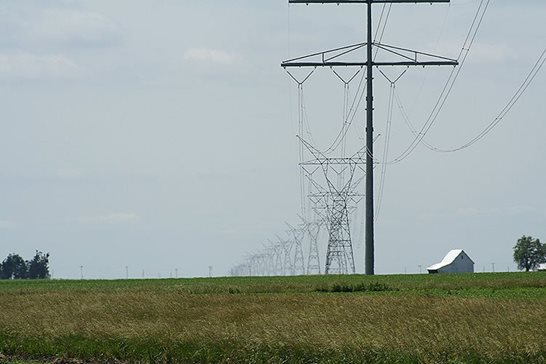 Power lines cross farmland near Illiopolis, Ill. The Illinois Supreme Court reversed a ruling that stopped construction of a powerline through the eastern part of the state. Dual Freq/Wikimedia Commons, via CC BY-SA 3.0