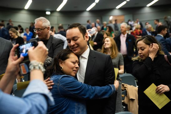 One of Illinois' 335 newest lawyers gets a congratulatory hug Thursday at the swearing-in ceremony at the Thompson Center.