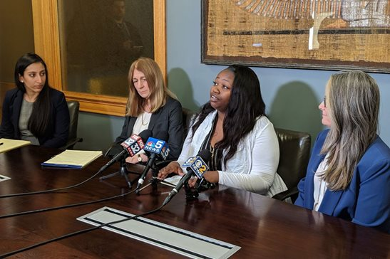 Speaking at a news conference Friday flanked by her attorneys, Dasha Davis said she was thankful a Cook County jury believed her and not the city of Chicago's account about her father, who was fatally shot by police officers in 2014.
