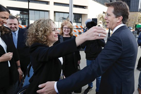 Plaintiff's attorneys Linda Singer and Mark Lanier hug outside the U.S. Federal courthouse Monday morning in Cleveland after they reached a $260 settlement on behalf of two Ohio counties with the nation's three dominant drug distributors and a big drugmaker related to the opioid crisis. The first federal trial over the crisis was due to begin Monday.
