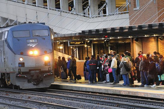 In this Dec. 14, 2015, photo, college students and other commuters line up to board a northbound Amtrak train in downstate Normal. In January, Amtrak updated its terms and conditions policies, effectively barring passengers from filing lawsuits and requiring disputes be taken to arbitration. Chicago's top plaintiff's lawyers say this policy may be a Seventh Amendment violation, while congressional lawmakers say they will look at what can be done with legislation to protect riders.