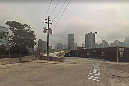 A Google Street View image from 2007 shows the site on West Erie Street where, in 2014, a car hit a telephone pole and rolled down a 25-foot drop. The driver thought it was a ramp onto the Kennedy Expressway. The injured passengers sued the city, alleging the city's failure to light and maintain the street were a cause of the crash.