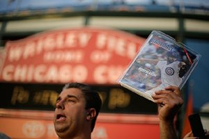 Vendor Matthew Smerge holds a copy of Chicago Baseball magazine outside Wrigley Field before Game 3 of the National League baseball championship series between the New York Mets and the Chicago Cubs on Oct. 20, 2015.