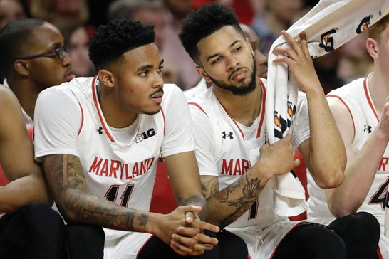 Former Maryland Terrapins basketball players Jared Nickens (left) and Jaylen Brantley sit on the bench in the final moments of game in February 2017. The duo sued a video game maker for copying a dance they popularized, but a federal judge has dismissed the case.