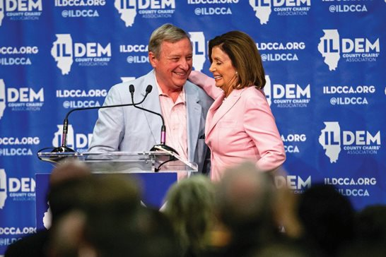 U.S. House Speaker Nancy Pelosi, D-Calif., hugs U.S. Sen. Richard J. Durbin, D-Ill., after he introduced her to be the keynote speaker during the 2019 Illinois Democratic County Chairs' Association Brunch at the Crowne Plaza Hotel Wednesday in Springfield.
