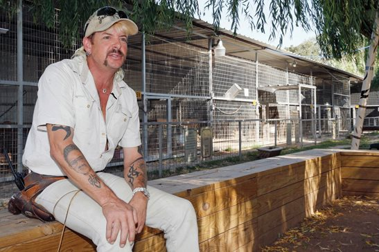 "Joseph Maldonado-Passage, also known as ""Joe Exotic,"" at his Oklahoma zoo in 2013. The former zookeeper was sentenced to 22 years in prison for his role in a murder-for-hire plot. Earlier this month, he filed a federal wrongful prosecution lawsuit seeking nearly $94 million in damages. He's the subject of a hit Netflix documentary series."