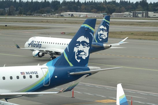 Alaska Airlines planes taxi at Seattle-Tacoma International Airport in Seattle. A federal judge in Chicago dismissed a suit against the airline for lack of jurisdiction after finding the circumstances that lead to a woman's fatal head injury while deplaning didn't happen in Illinois.