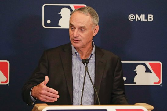 MLB Commissioner Rob Manfred answers questions at a press conference during a February MLB owners meeting in Orlando, Fla.
