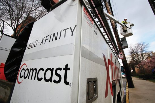A Comcast technician performs work in this file photo. A state appeals panel this week ruled that more than $410,000 in franchise fees paid by Comcast to Kane County should have gone to the village of Campton Hills shortly after it incorporated in 2007.