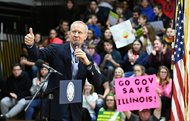 Gov. Bruce Rauner acknowledges the crowd's applause before signing Senate Bill 2814, the Future Energy Jobs Bill, at Riverdale High School in Port Byron earlier this month. Today, Rauner donated $50 million to his 2018 gubernatorial campaign.
