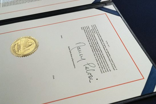 The signature of House Speaker Nancy Pelosi of Calif., is on the article of impeachment against President Donald Trump, after an engrossment ceremony before transmission to the Senate for trial on Wednesday in Washington.