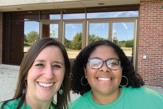 Elizabeth R. Olszewski (left) poses with Waukegan High School senior Aliyah Plummer outside the student center at the University of Wisconsin-Parkside during a college visit. The Salvi, Schostok & Pritchard P.C. associate mentors Plummer as part of a program for students at the north suburban high school.