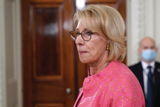 "Education Secretary Betsy DeVos arrives at the White House, Wednesday. A federal judge allowed the Education Department to move forward with new rules governing how schools and universities respond to complaints of sexual assault. DeVos said the ruling is ""yet another victory for students and reaffirms that students' rights under Title IX go hand in hand with basic American principles of fairness and due process."""