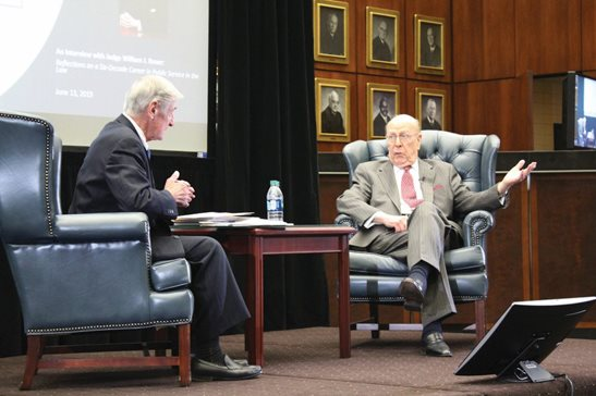 7th U.S. Circuit Court of Appeals Judge William J. Bauer (right) talks about his career as a prosecutor and judge with U.S. District Judge Charles P. Kocoras Thursday at the Dirksen Federal Courthouse as part of a special program marking the 200th anniversary of the federal court being established in Chicago. Bauer, 92, has been in public service for 67 years.