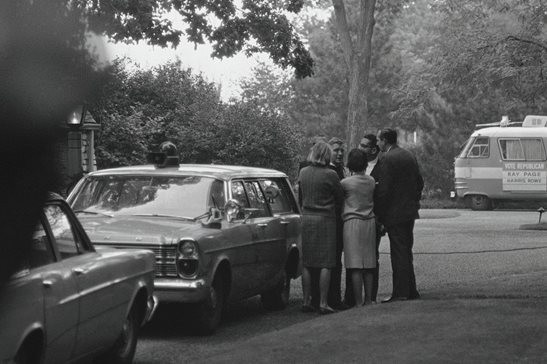 Charles Percy (center, rear), industrialist and 1966 GOP nominee for the U.S. Senate, is consoled by friends on the lawn of his Kenilwoth home in September 1966 after his 21-year-old daughter, Valerie, was found slain in her bedroom. Last week, a state appeals panel said Kenilworth and several government agencies can't claim a blanket exemption from FOIA regarding the still-unsolved murder.