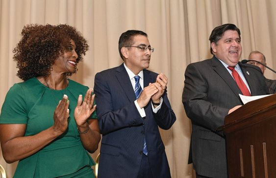 Cook County State's Attorney's Juvenile Justice Bureau Chief Maryam Ahmad and Deputy Gov. Jesse Ruiz applaud Gov. J.B. Pritzker at The Chicago Bar Association's annual meeting Tuesday. Ahmad was sworn in as first vice president and Ruiz was sworn in as president.