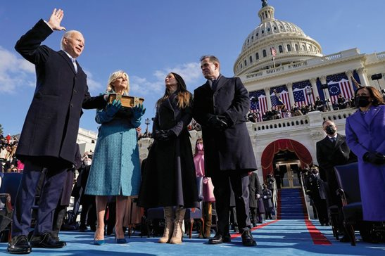Joe Biden is sworn in as the 46th president of the United States by Chief Justice John Roberts as Jill Biden holds the Bible during the 59th Presidential Inauguration at the U.S. Capitol on Wednesday, as their children Ashley and Hunter watch.