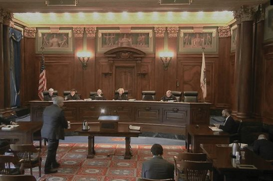 R. Chris Heck, a partner at Kirkland & Ellis LLP, defending the city of Chicago in a case over lead contamination of residents' water supply, approaches the podium moments before oral arguments at the Illinois Supreme Court on Wednesday in Springfield.