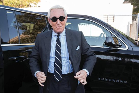 "Roger Stone arrives at federal court for his trial in Washington, D.C., last November. The Justice Department said Tuesday it will take the extraordinary step of lowering the amount of prison time it will seek for Roger Stone, an announcement that came just hours after President Donald Trump complained that the recommended sentence for his longtime ally and confidant was ""very horrible and unfair."""