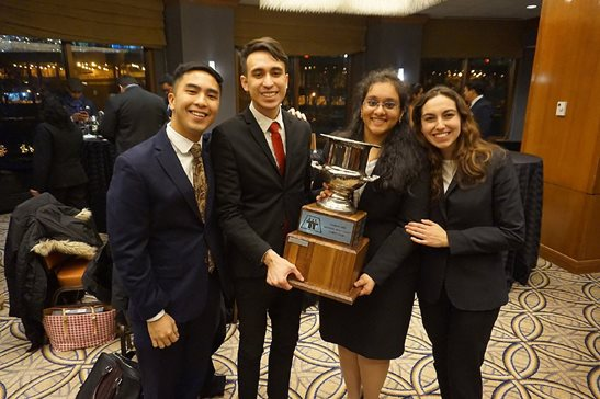 Loyola University Chicago School of Law students Matthew Yasuoka and Prathyusha Matam (both center, holding trophy) won the national Thomas Tang Moot Court Competition last weekend. On either side of them are Loyola students Justin Sia (left) and Patricia Martin (right), who won the regional competition in Madison and advanced to nationals.