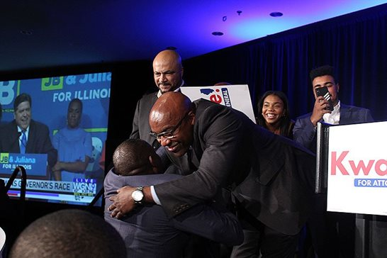 State Sen. Kwame Y. Raoul hugs a supporter during a victory party at the Fairmont Chicago Millennium Park after he collected 54 percent of the vote to become the new Illinois attorney general by beating Republican Erika L. Harold.