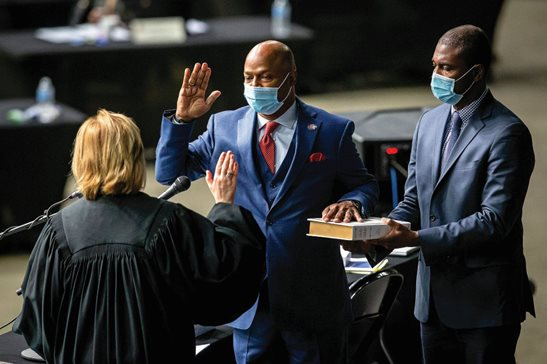 "State Rep. Emanuel ""Chris"" Welch, D-Hillside, takes the oath of office to become Speaker of the House for the 102nd General Assembly at the Bank of Springfield Center on Wednesday."