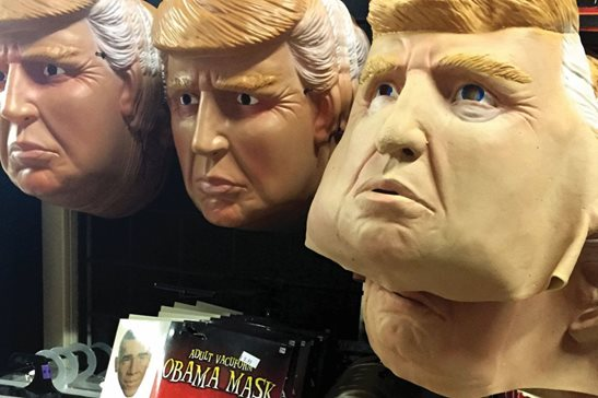 Halloween masks of then-presidential candidate Donald Trump hang on display in a California shop in 2016. Last week in Chicago, a federal judge ordered a hospital to turn over a Trump mask allegedly worn by one of its doctors during an interview with a Latina employee.