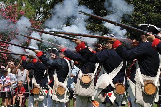 "The 1st NC Regiment of the Continental Line fire muskets at The Glorious Fourth event at Tryon Palace in New Bern, N.C., July 4, 2018. A group of academics from the University of Chicago and the University of Illinois have filed an amicus brief stating the phrase ""keep and bear arms"" was used in military rather than individual context during the Revolutionary era."