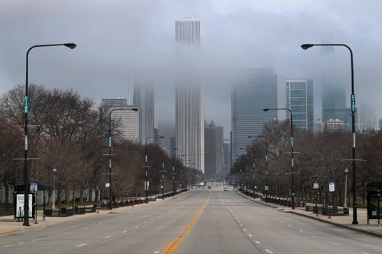 Fog lifts over Chicago and the usually busy Columbus Drive on Tuesday, the second work day since Gov. J.B. Pritzker issued a stay-at-home order last week due to the coronavirus.