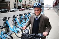 James W. Ozog, a partner at Goldberg, Segalla, uses the Divvy bike-share system to cut transit time between his office and state and federal courts.