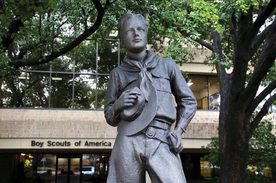 A statue outside the Boys Scouts of America headquarters in Irving, Texas. The Boy Scouts of America filed for bankruptcy protection this morning in Delaware federal court as it faces a barrage of new sex abuse lawsuits. The filing is an attempt to work out a potentially 10-figure compensation plan for abuse victims.