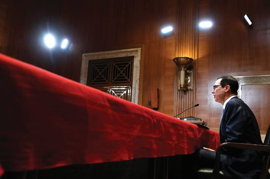 Treasury Secretary Steve Mnuchin testifies about the budget during a Financial Services and General Government subcommittee hearing Wednesday morning on Capitol Hill.