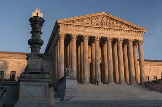 In this Nov. 6, 2020, file photo the Supreme Court is seen at sundown in Washington. The Supreme Court says it will not hear a case out of Pennsylvania related to the 2020 election, a case that had lingered while similar election challenges had already been rejected by the justices. The high court directed a lower court to dismiss the case as moot.