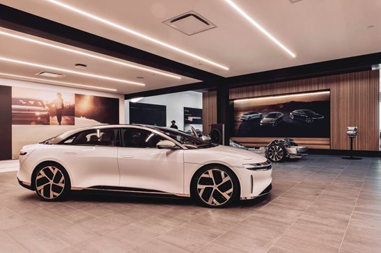 A Lucid Air inside a showroom. A new lawsuit filed in Cook County alleges two electric vehicle manufacturers, Rivian and Lucid Motors, are taking online orders for direct sales in Illinois. The dealerships argue state law requires car makers to contract with independently franchised dealerships.