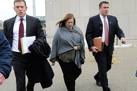 Melodie Gliniewicz, the  wife of a disgraced Illinois police officer who staged his suicide, walks out the Lake County Courthouse in Waukegan with her lawyers after a February  2016 hearing. A state appeals panel held this month that the trial judge should have allowed prosecutors to submit what they contend is newly discovered evidence not protected by spousal privilege. Mark Welsh/Daily Herald via AP
