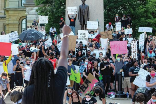 Protesters gather outside the Illinois Capitol in Springfield Monday to protest police brutality following the May 25 death of George Floyd in Minneapolis.