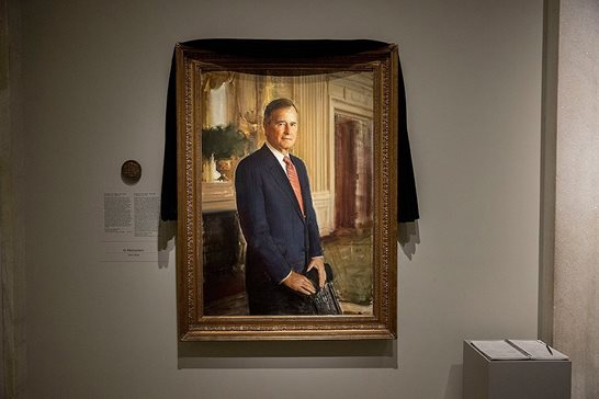 The official portrait of former President George H.W. Bush is draped in black cloth at the National Portrait Gallery in Washington, D.C., on Monday to mark his death. As part of a national day of mourning declared by President Donald Trump for this Wednesday, Chicago's federal courthouse will go quiet for the day.