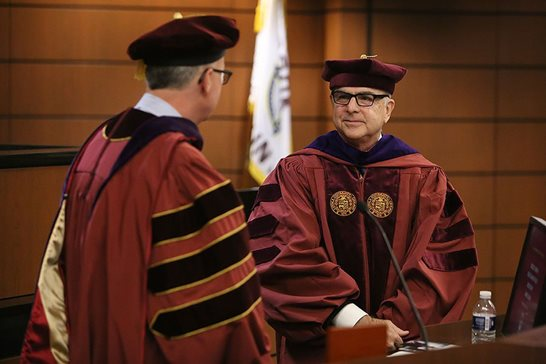 Loyola University Chicago School of Law professor John D. Blum (right) was inducted to the school's Beazley Chair in Health Law and Policy in a ceremony last month. Photo provided by Loyola University of Chicago School of Law