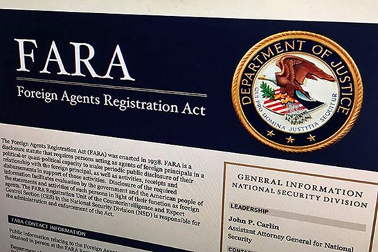 A portion of the website for fara.gov, on the Foreign Agents Registration Act, is seen photographed in Washington, D.C., in August 2016. A push to give the Justice Department more enforcement authority over the lucrative and at times shadowy world of foreign lobbying is stalled amid opposition from pro-business groups, nonprofits and privacy advocates.
