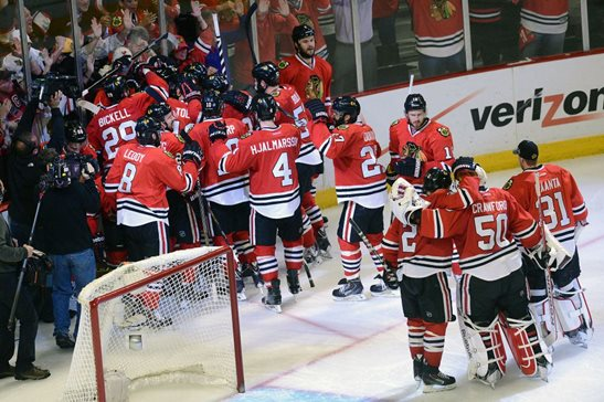 Blackhawks center Michal Handzus is surrounded by teammates after scoring the game-winning goal in Game 5 of the 2014 Western Conference finals against the Los Angeles Kings. Roughly around this same moment, a patron at Kinkade's threw a beer bottle at the ceiling.