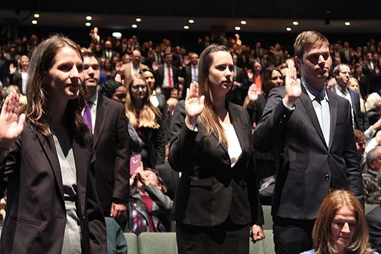 Close to 500 former law school students who passed the bar exam pledge to follow the Constitution and the Illinois rules of professional ethics Thursday at the Arie Crown Theatre at McCormick Place. The morning ceremony was followed by another in the afternoon. More than 1,200 future lawyers were swore in across the state. Brenna Field (left to right) along with Monica Kreymer and Duncan Lamphere take the lawyer's oath.