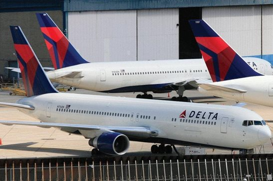 Delta Air Lines jets are parked at John F. Kennedy International Airport in New York in this 2010 file photo. U.S. Customs and Border Protection will issue a new policy directive under a settlement agreement that states airline passengers are not required to consent to document checks. The settlement comes in a lawsuit filed by passengers aboard a Delta flight from San Francisco to New York in February 2017 who were met by CBP officers and forced to hand over identification as they deplaned. It was just a few weeks after President Donald Trump's first travel ban.
