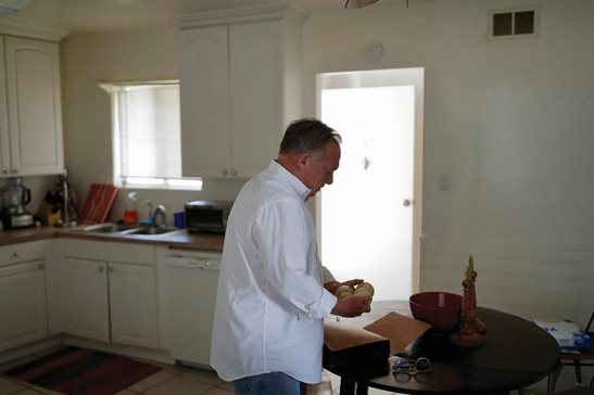 David Lasher holds baseballs at his home in Carlsbad, Calif., on Oct. 4. When Lasher reported sexual abuse by a priest to an independent review board in St. Petersburg, Fla., , the board ruled against him.