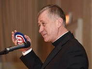 Archbishop Blase Cupich holds a Cubs-themed yarmulke given to him by Rabbi Steven Stark Lowenstein at a Chicago Bar Association luncheon on Thursday. Cupich, who will formally become a cardinal next month in Rome, joked that he may show the Jewish skullcap to the pope when they meet.