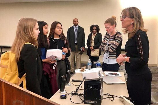 Cook County Associate Judge Jeanne M. Reynolds (far right) speaks to high school students after the conclusion of Women Everywhere's annual Education Day April 18 at the Skokie Courthouse. This year's program brought 110 high school boys and girls to the courthouse to meet and interact with legal professionals, courthouse employees and other court personnel.