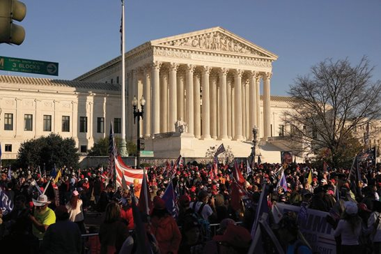 Supporters of President Donald Trump attend pro-Trump marches outside the Supreme Court Building in Washington on Nov. 14. The U.S. Supreme Court is hearing arguments Monday over whether the Trump administration can exclude people in the country illegally from the count used for divvying up congressional seats. AP Photo/Jacquelyn Martin, File
